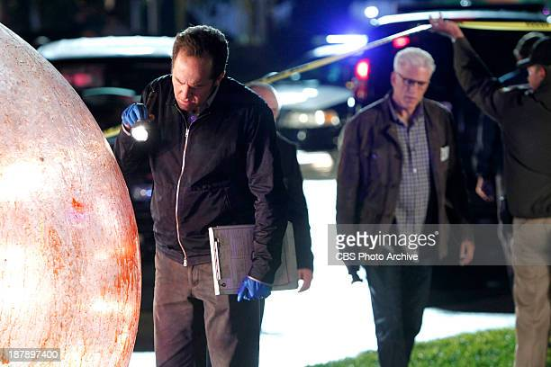 """Helpless"""" - David Phillips examines a large human- sized hamster ball at the crime scene as D.B. Russell arrives, on CSI CRIME SCENE INVESTIGATION,..."""