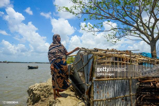 Helpless woman puzzled after losing her house after the landfall of cyclone Amphan. Thousands of shrimp enclosures have been washed away, while...