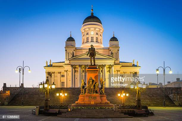 Helsinki Cathedral illuminated at dusk overlooking Senate Square Finland