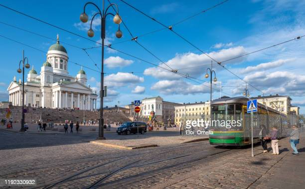 helsinki cathedral (st nicholas' church) on senate square with tram, helsinki, finland - st. nicholas cathedral stock pictures, royalty-free photos & images