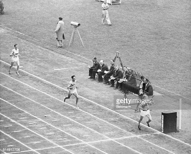 Czech Runner Wins 5000 Meter event Emil Zatopek of Czechoslovakia streaks across the finish line to win the 5000 meter Olympic championship at...