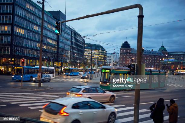 helsinki downtown traffic in the dusk evening light - helsinki stock pictures, royalty-free photos & images