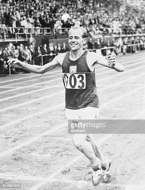 Emil Zapotek of Czechoslovakia set us a new Olympic record for 500M when he won the final of the event at the Olympic Stadium in 14 min 66 secs...