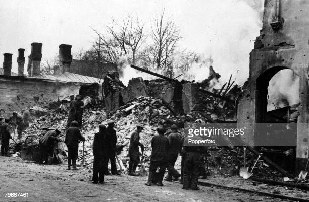 Helsinki Finland 9th December A rescue squad at work in the burning ruins of houses in Helsinki following a Russian bombing raid on the Finnish...