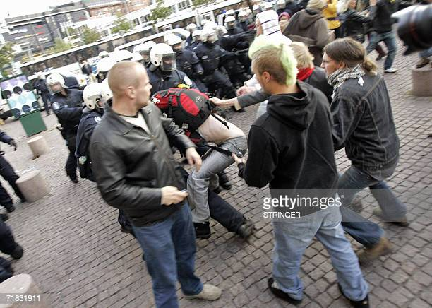 Finnish riot police confront demonstrators during an anarchist demonstration called 'Smash ASEM' in Helsinki 09 September 2006 European Union leaders...