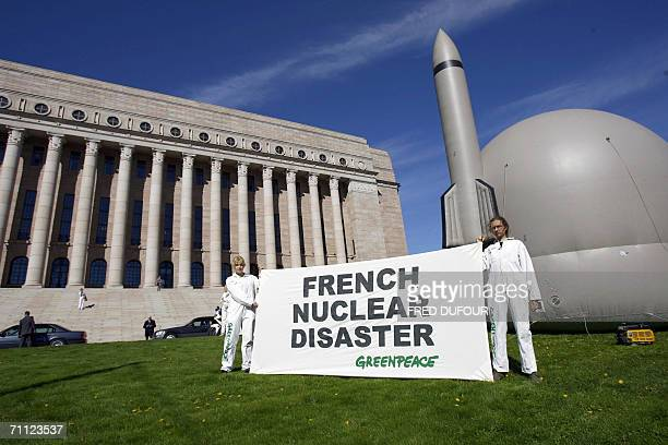 Greenpeace activists demonstrate 05 June 2006 in front of the Finnish Parliament against the construction of the world's first thirdgeneration...