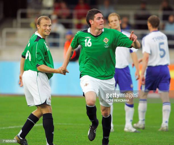 Kyle Lafferty celebrates his 02 goal with Warren Feeney during the friendly football match Finland vs Northern Ireland in Helsinki 16 August 2006 AFP...