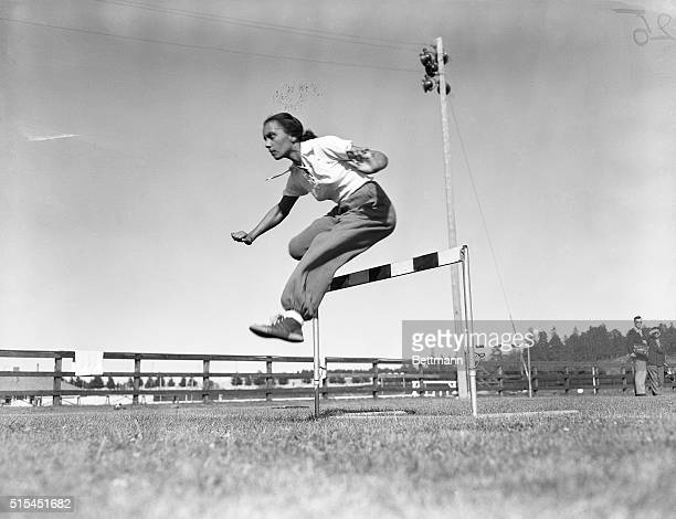 7/11/1952 Helsinki Finland Miss Wanda Dos Santos of the 1952 Brazilian Olympic Team takes a hurdle with graceful agility during a training session at...