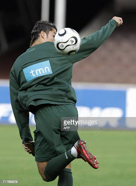 Portuguese national football team star Cristiano Ronaldo takes part in a training session at the Olympic Stadium in Helsinki 05 September 2006 ahead...