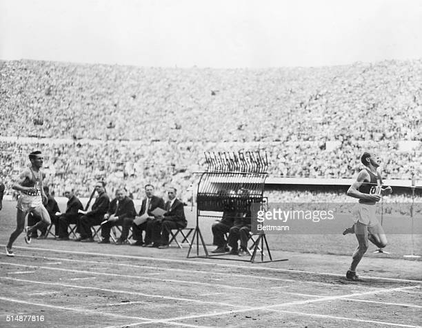7/24/1952FINISH OF THE 5000 METERS AT THE OLYMPIC STADIUM Helsinki Finland Today showing Emil Zatopek winning from A Mimouin and H Schade 3rd All...