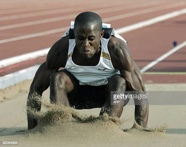 US Dwight Phillips performs in men's long jump at the Helsinki GP event in the Helsinki Olympic Stadium 25 July 2005 Phillips won the competition...