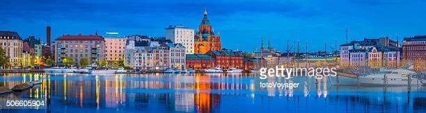 Helsinki harbour Uspenski Cathedral yacht marina illuminated at dusk FInland