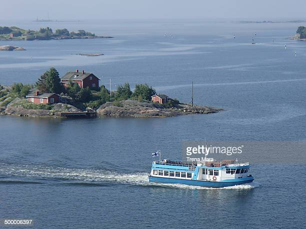 Helsinki Harbour with ferry boat passing a small island