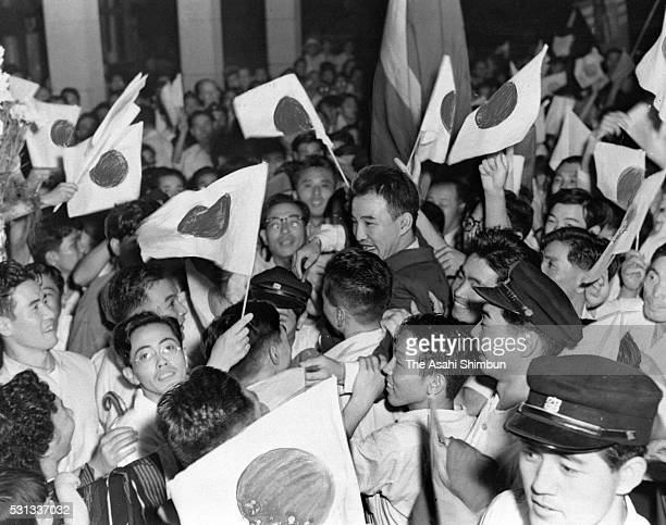 Helsinki Olympic Wrestling Freestyle Bantamweight gold medalist Shohachi Ishii is welcomed by fans on arrival at the Tokyo International Airport on...