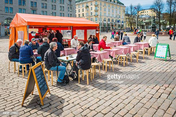 Helsinki people at outdoor cafe stall in Market Square Finland