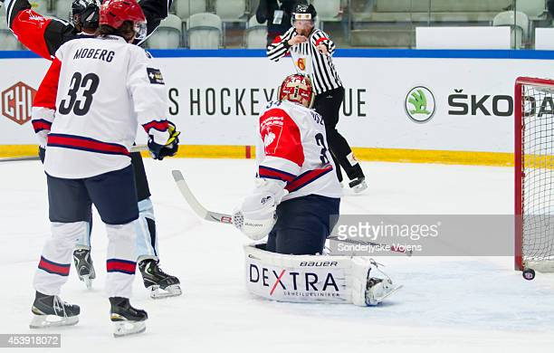 Helsinki players looks on dejected as they concede a goal Scored by Anders Overmark during the Champions Hockey League group stage game between...