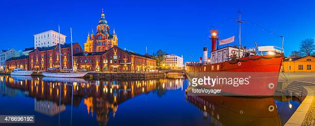 helsinki uspenski cathedral overlooking tranquil waterfront harbour illuminated dusk finland - helsinki stockfoto's en -beelden