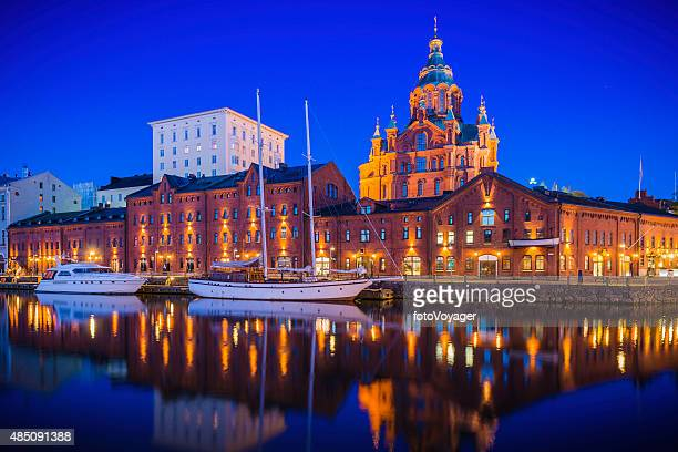 helsinki uspenski cathedral reflecting in illuminated marina tranquil waterfront finland - helsinki stockfoto's en -beelden