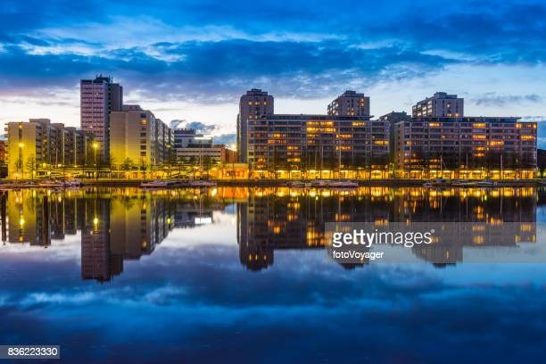 Helsinki waterfront apartments overlooking harbour Merihaka illuminated at sunset Finland