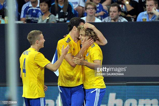 Helsinki's Berat Sadik and Alexander Ring celebrate Teemu Pukki's goal, which brought the score to 1-1, during their Europa League play-off round...