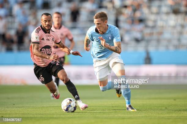 Helsinki's Brazilian midfielder Jair Tavares Silva and Malmo's Danish midfielder Soren Rieks vie for the ball during the UEFA Champions League...