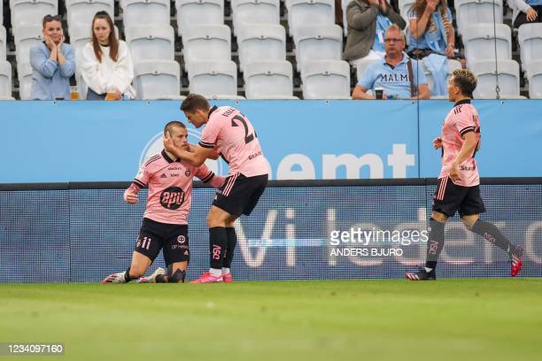 Helsinki's Finnish forward Roope Riski celebrates his 1-1 goal during the UEFA Champions League qualifying football match between Malmo and HJK...