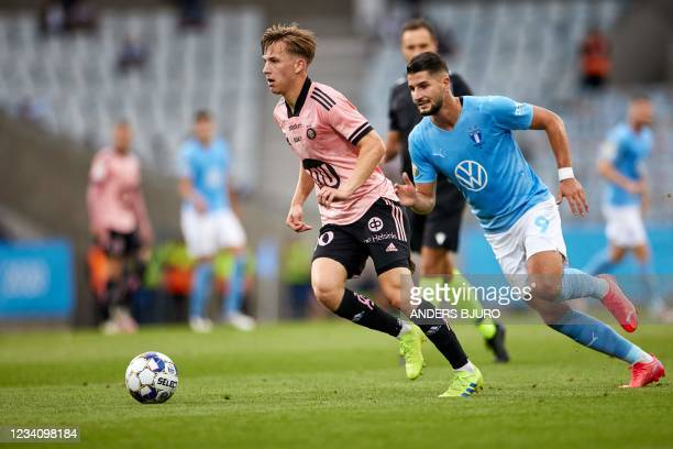 Helsinki's Finnish midfielder Lucas Lingman and Malmo's Croatian forward Antonio Colak vie for the ball during the UEFA Champions League qualifying...