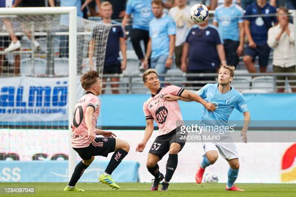 Helsinki's Japanese forward Atomu Tanaka , Helsinki's Finnish midfielder Lucas Lingman vie with Malmo's Swedish midfielder Oscar Lewicki during the...