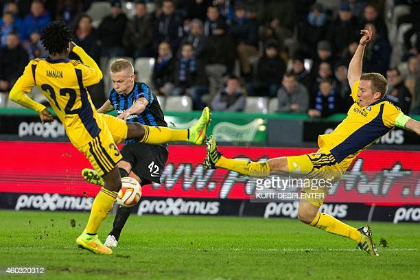 Helsinki's midfielder Anthony Annan and Brugge's Nikola Storm vie for the ball during the UEFA Europa League group B football match between Club...