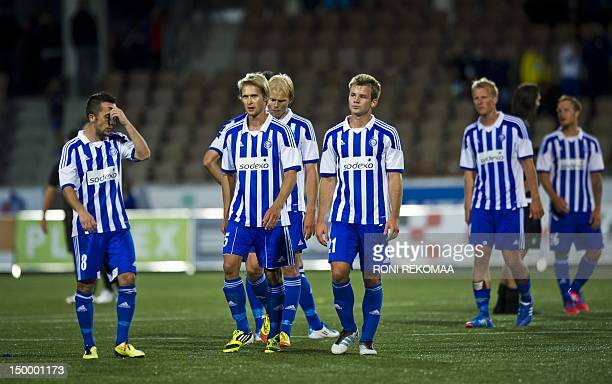 Helsinki's players react at the end of the UEFA Champions League third qualifying round second leg football match between HJK Helsinki and Glasgow...