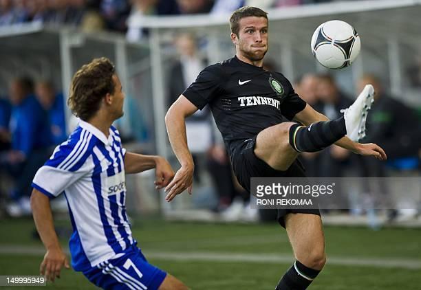 Helsinki's Sebastian Mannstrom vies with Glasgow Celtic's Adam Matthews during their UEFA Champions League third qualifying round second leg football...