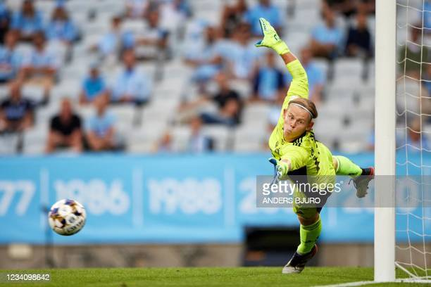 Helsinki's Swedish goalkeeper Jakob Tannander lets the 2-1 goal for Malmo in during the UEFA Champions League qualifying football match between Malmo...