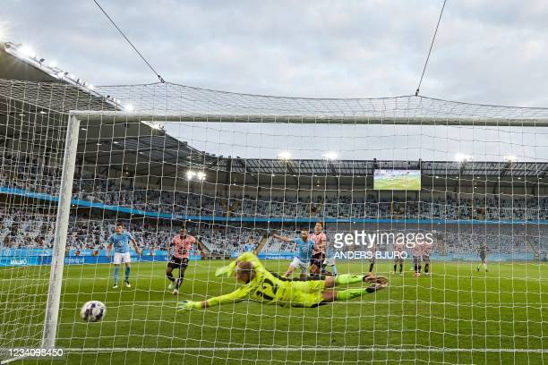 Helsinki's Swedish goalkeeper Jakob Tannander lets the 2-1 goal in for Malmo scored by Malmo's Danish midfielder Anders Christiansen during the UEFA...