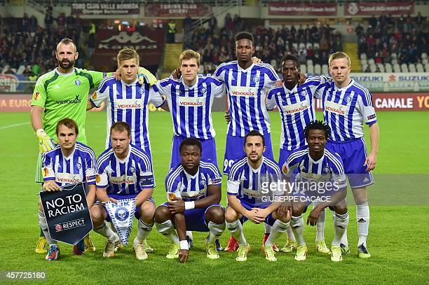 Helsinki's team pose before their UEFA Europa League football match Torino vs HJK Helsinki on October 23 at the Olympic Stadium in Turin. AFP PHOTO /...