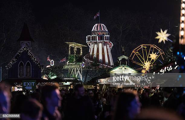 A helter skelter amongst crowds and Christmas stalls at the Winter Wonderland in Hyde Park on December 21 2016 in London England Winter Wonderland is...