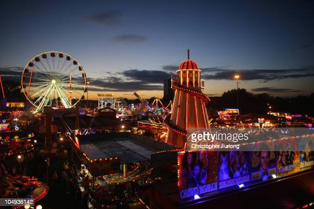 A helter skelter illuminates the sky as revellers enjoy the thrills and fun of the traditional fair ground at the annual Goose Fair on October 6 2010...