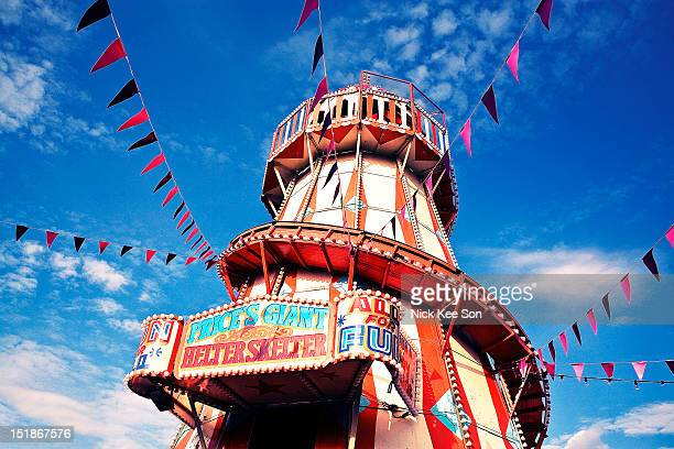 helter skelter with bunting - carnival stock photos and pictures