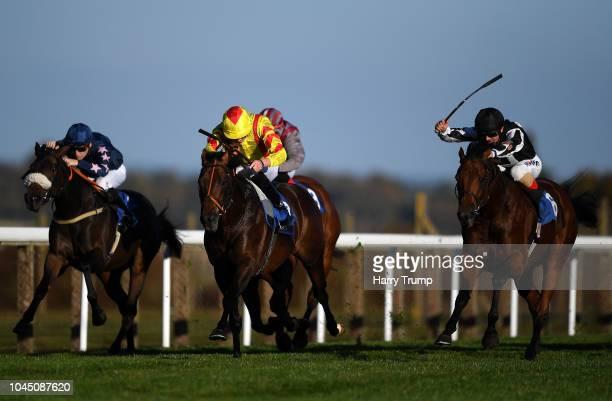 Helvetian ridden by Andrea Atzeni win the Weatherbys General Stud Book Handicap at Salisbury Racecourse on October 3 2018 in Salisbury England