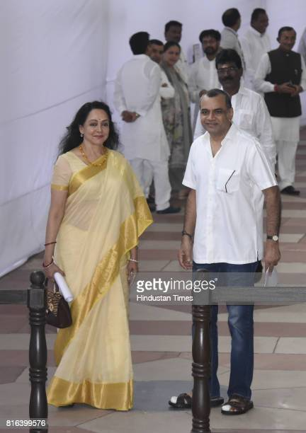 Hema Malini and Paresh Rawal before casting their votes during the presidential election at the Parliament House on July 17 2017 in New Delhi India...