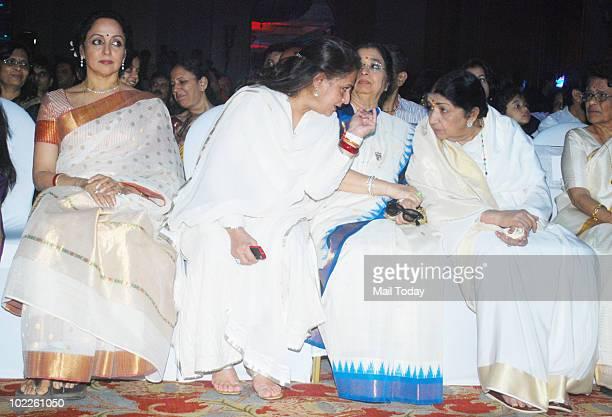 Hema Malini Jaya Bachchan Usha Mangeshkar and Lata Mangeshkar at the launch of Chehere a coffee table book compiled by celebrity photographer Gautam...