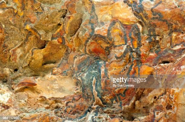 hematite ochre stone texture, serra gelada natural park, albir, alicante, spain - iron ore stock photos and pictures