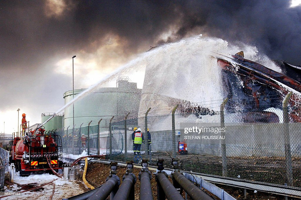 Firefighters continue to pour foam onto : News Photo