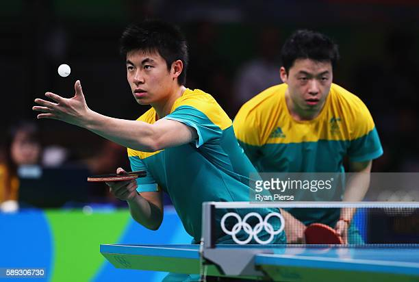 Heming Hu and Xinduring Yan of Australia serve during the Table Tennis Men's Team Round One Match between Australia and Hong Kong during Day 8 of the...