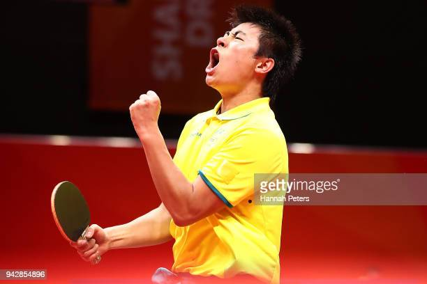 Heming Hu of Australia celebrates a point during his quarterfinal Table Tennis match against Bode Abiodun of Nigeria on day three of the Gold Coast...
