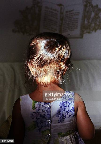 Hemo Naitoko looks over the body of her father Halatau Naitoko after he returned to his home on January 25 2009 in Auckland New Zealand 17yearold...