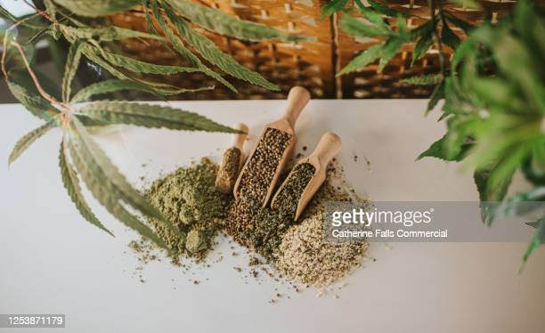 hemp in scoops in various forms - cannabis store stock pictures, royalty-free photos & images