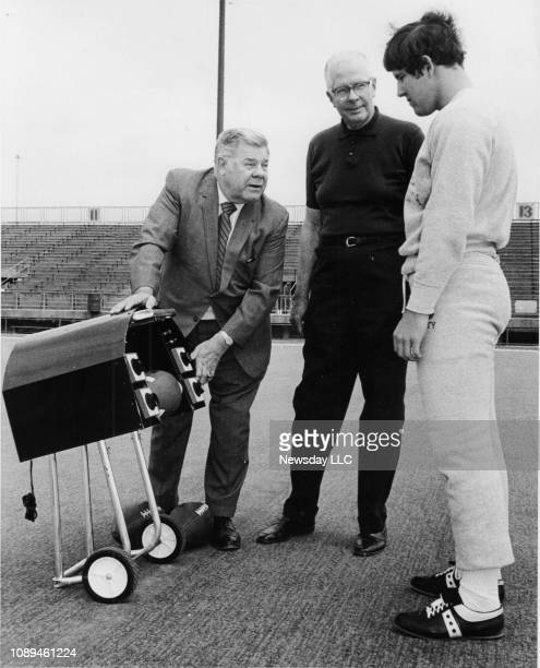 New York Jets head coach Weeb Ewbank shows a new timing device for football players to Hofstra University football coach Howdy Myers and quarterback...