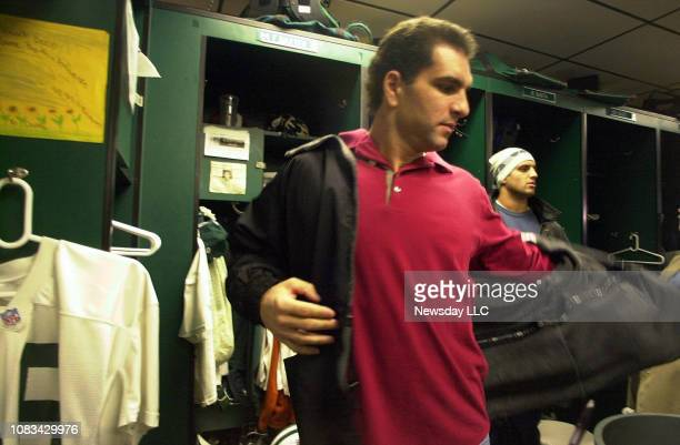 New York Jets quarterback Vinny Testaverde puts his jacket on in the locker room at the Jets training facility in Hempstead New York on December 26...