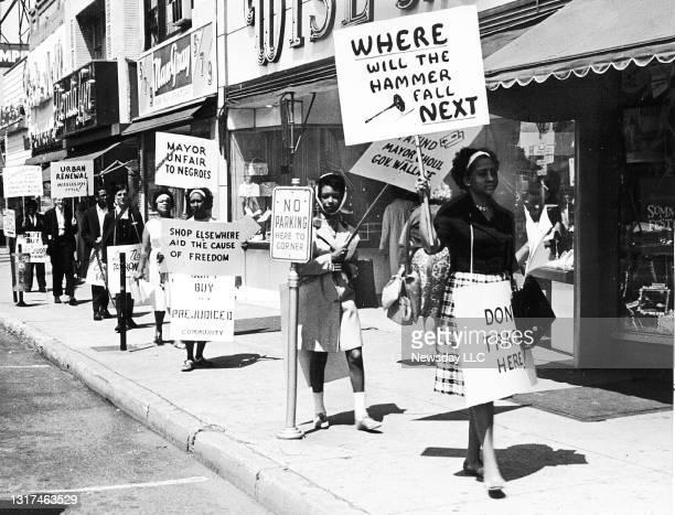 On June 21 members of the Hempstead Lake Civic Association in Hempstead, New York, demonstrate against the Hempstead Village Board's practice of...