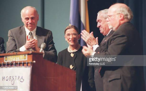 US Supreme Court Justice Ruth Bader Ginsburg second from left is applauded by her Hofstra University hosts after her speech on legal ethics on March...